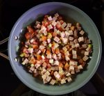 Cubed ham with tomato and spring onions